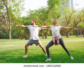 Couple exercising in the park.