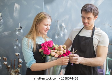 couple with exquisite taste making bouquet together