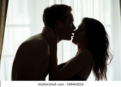Couple with eyes closed. Woman touching man's neck. Addicted to your kisses.