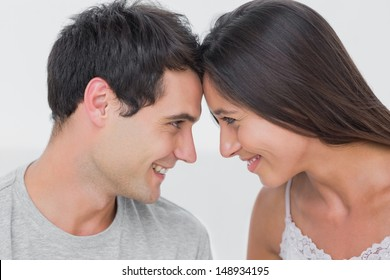 Couple facing each other in bed