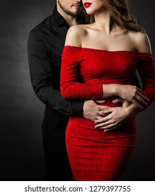 Couple Fashion Beauty, Young Woman in Sexy Red Dress and Embracing Man in Love