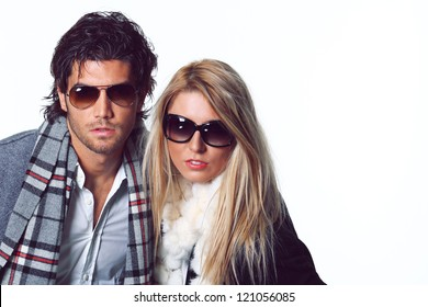 Couple of fashion models with sunglasses. Studio shot