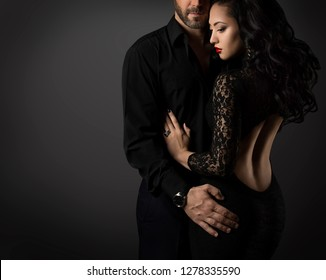 Couple Fashion Portrait, Embracing Man and Sexy Woman in Black Dress