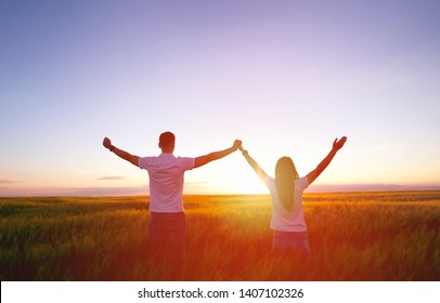 Couple feeling free in a beautiful natural setting.