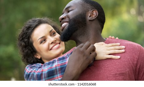 Couple feeling love and support of each other, multiethnic relations, family