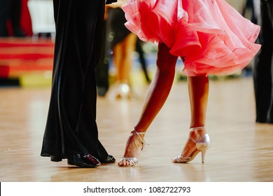 couple feet of dancers, woman and man latino dancing