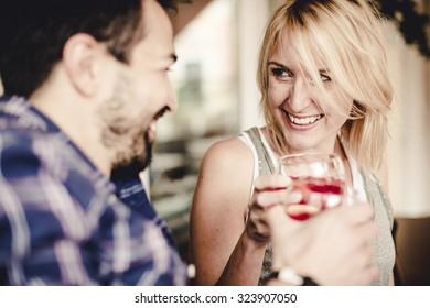 Couple flirting at the Bar