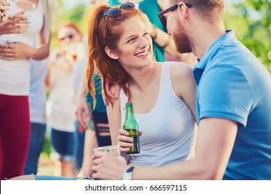 Couple flirting at outdoor party