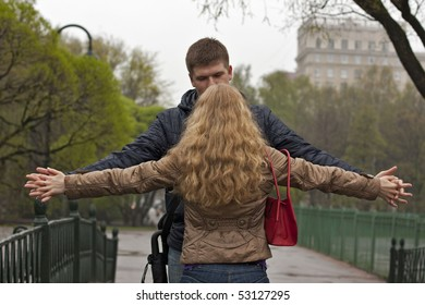 couple with flying hands outdoors