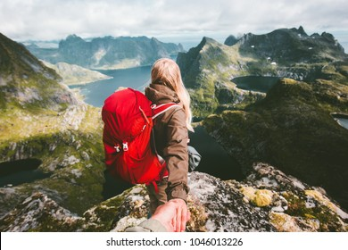 Couple follow holding hands on cliff mountain in Norway Travel lifestyle love emotions concept summer vacations family outdoor Lofoten islands
