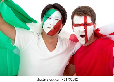 Couple of football fans looking happy with their faces painted - Isolated over white