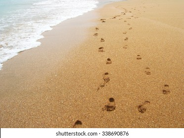 A couple of footprints on a pristine sand beach