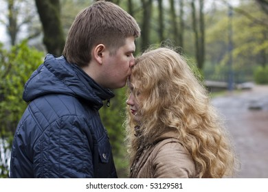 couple forehead kissing outdoors in spring