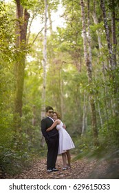 A couple in formal dress black suit and white dress romance in the pine forest before wedding, Thailand