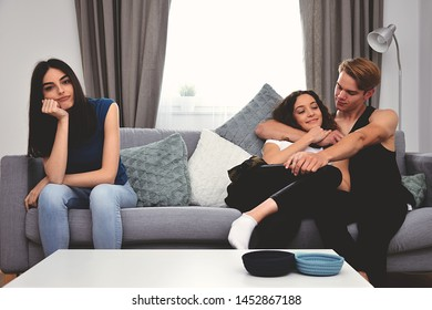 couple and friend, relationship and friendship challenge, three people, teenagers sitting on sofa, bored and  jealousy third person concept