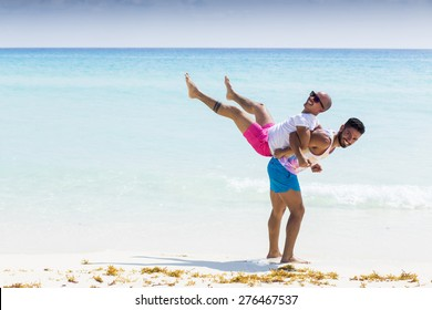 Couple of friends having fun at the beach in the Caribbean