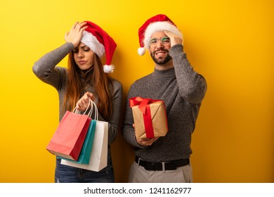 Couple or friends holding gifts and shopping bags forgetful, realize something