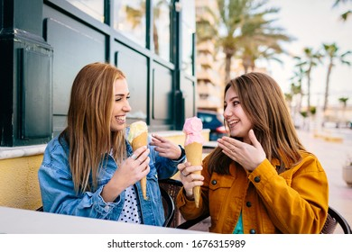 a couple of friends share their strawberry and vanilla ice creams