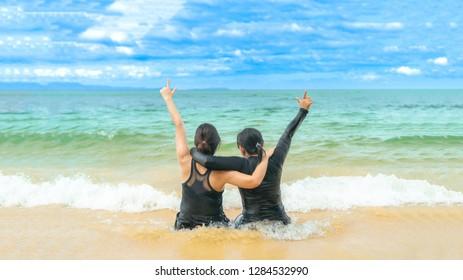 Couple of friendship woman on beach
