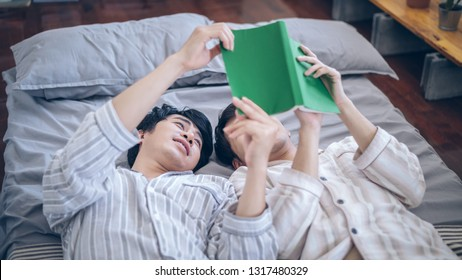 Couple gay read a book,Homosexuality, gay men's doubles pair of masculine romance at home