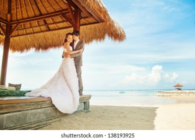 couple in gazebo on wedding day