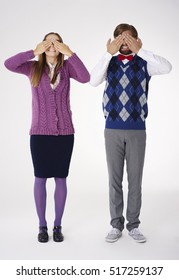Couple geek covering eyes by hands