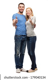couple, gesture and family concept - smiling couple showing thumbs up