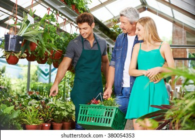 Couple getting consultation in nursery shop from a gardener