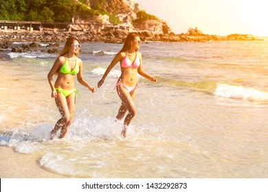 Couple girl running on the beach relaxing summer vacation.Young fashion woman relax on the beach. Happy island lifestyle.crystal. Vacation at Paradise. Ocean beach relax. - Shutterstock ID 1432292873