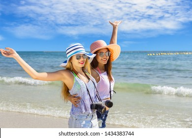 Couple girl running on the beach relaxing summer vacation.Young fashion woman relax on the beach. Happy island lifestyle.crystal. Vacation at Paradise. Ocean beach relax. - Shutterstock ID 1434383744