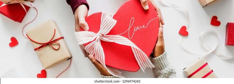 Couple giving a present on valentines day