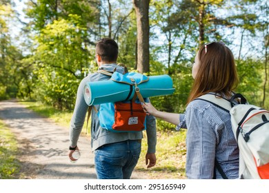 couple goes hiking, forest, recreation, love, active lifestyle - Shutterstock ID 295165949