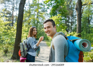 couple goes hiking, forest, recreation, love, active lifestyle - Shutterstock ID 295166009