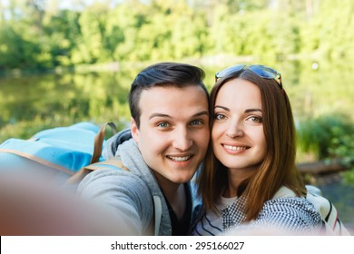 couple goes hiking, forest, recreation, love, active lifestyle - Shutterstock ID 295166027