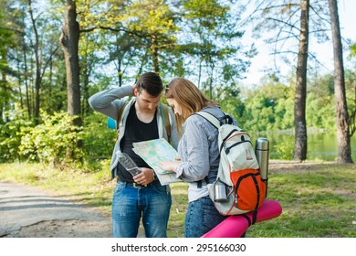 couple goes hiking, forest, recreation, love, active lifestyle - Shutterstock ID 295166030