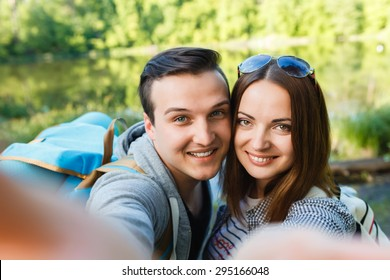 couple goes hiking, forest, recreation, love, active lifestyle - Shutterstock ID 295166048