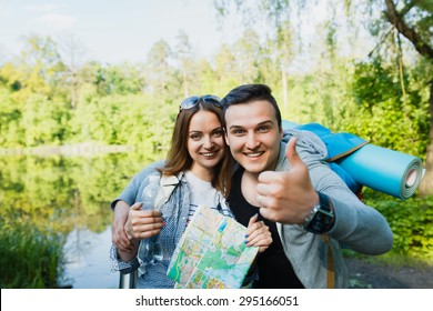 couple goes hiking, forest, recreation, love, active lifestyle - Shutterstock ID 295166051