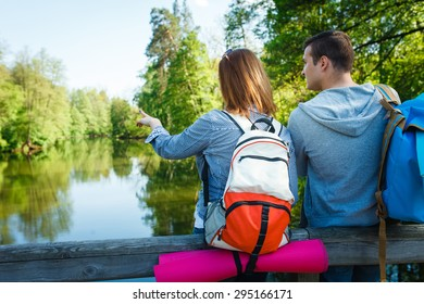 couple goes hiking, forest, recreation, love, active lifestyle - Shutterstock ID 295166171