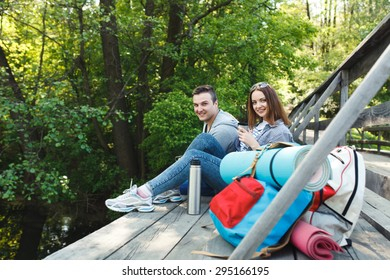 couple goes hiking, forest, recreation, love, active lifestyle - Shutterstock ID 295166195