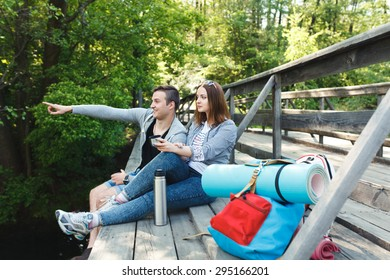 couple goes hiking, forest, recreation, love, active lifestyle - Shutterstock ID 295166201