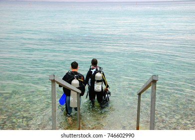 Couple going to dive. Eilat, Israel. Coral Beach Nature Reserve, one of the most beautiful coral reef in the world, is famous tourist and diver attraction.