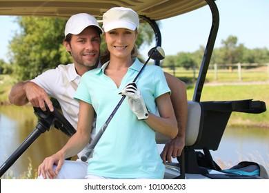 Couple in golf car