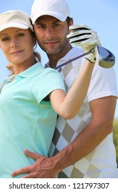 Couple with golf club