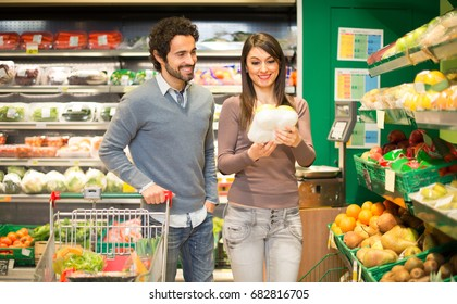 Couple grocery shopping in a supermarket