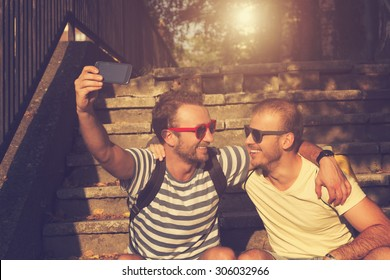 Couple of guys doing a selfie.