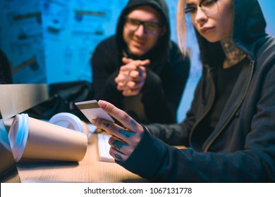 couple of hackers with stolen credit card at workplace