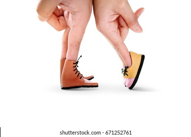 Couple hand finger walk to kiss with shoe isolated on white background concept, Feet of the kissing couple