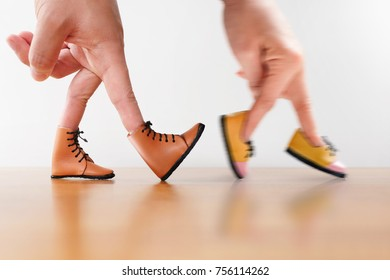 Couple hand finger walking with shoe concept, Walk together concept