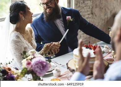 Couple Hands Holding Wedding Cake Knife
