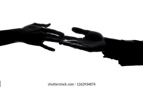 Couple hands separating, relations conflict, losing love partner, breakup symbol